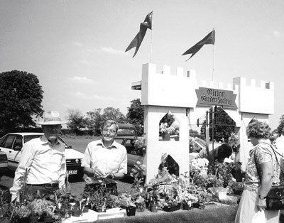 Chairman John Brookes, assisted by Treasurer Harold Ballinger, man the Girton Garden Society plant stall on the Recreation Ground, 1991